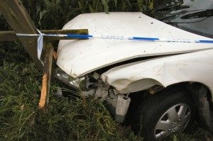 White-vehicle-after-auto-accident-300x199