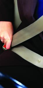 Person buckling seatbelt
